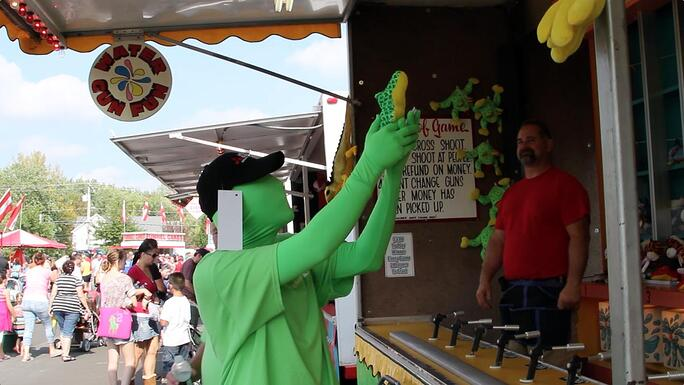ECI Green Man showing off his prize at the Bensalem Fall Festival